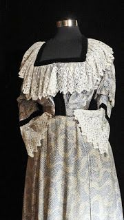 Edwardian Day Dress with Swirly Print..A beautiful late 19th century or early 20th century Victorian or Belle Epoque blue and white silk evening gown with lace and velvet trim and train. I have included an illustration of two 1890s Belle Epoque Paris evening gowns that have many similarities with this dress