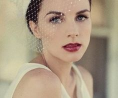 But what about the lips?? The dark red, dramatic lips here are amazing, and seem to add a classic vibe (or is that just the birdcage?)   Another wedding make up idea.