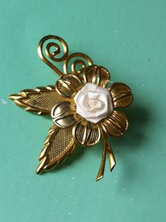 Beautiful 50s brass rose and fabric antique by yorkshiretreasure