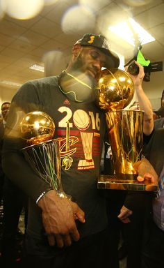 LeBron James of the Cleveland Cavaliers celebrates after winning Game Seven of the 2016 NBA Finals against the Golden State Warriors on June 19 2016...