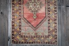 Rental piece: The Parva. Turkish Area Rug. The Parva is a vintage handmade Turkish rug, with delicate, feminine coloring. The fading of the red yarn into pink creates a beautiful natural ombre.  The Parva is also available as part of The Whistow lounge package.