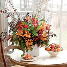 For an arrangement that will last through Thanksgiving, place a potted oncidium orchid in a large, lined cachepot, and surround it with wate...