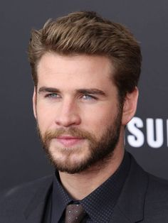 Mild Quiff - Liam Hemsworth sports a short quiff that's stylish yet conservative. With the quiff's subtle styling and neat appearance, this hairstyle could fit right in at work or class.