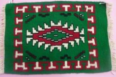 """Name of the product -Table mat Material -Wool,Tana,Synthetic thread Size       -12x16"""" Time frame – Eight Days Cost -Rs 300/-"""