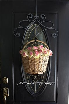 This gorgeous front door with rose-filled hanging basket is stunning!