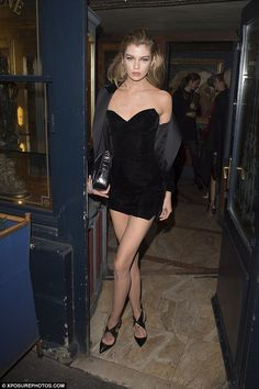 What a dress:Stella Maxwell chose a miniscule little black dress for the final night of P...