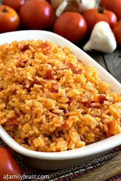 Portuguese Tomato Rice - also known as Arroz de Tomate. A simple and delicious rice dish that is a favorite recipe from Portugal! (similar to Greek tomato rice) Portuguese Rice, Portuguese Recipes, Learn Portuguese, Side Dish Recipes, Rice Recipes, Cooking Recipes, Couscous Recipes, Casserole Recipes, Cooking Tips