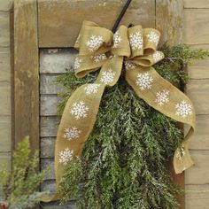 Decorate for the holidays in country style using this rustic jute burlap ribbon. Features white printed snowflakes on natural colored ribbon. Add to swags, gift wrap, or a wreath. Use as a garland on your tree - or anywhere you want to decorate. Measures 10-ft in length and 2-in width. #christmas #snowflake #burlap #bow