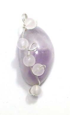 """Amethyst, White Jade & Sterling Silver Pendant  £19.65  This pendant is made of semi-precious amethyst, white chinese jade and sterling silver. It has a drop of 3.5cm (1.5"""")."""
