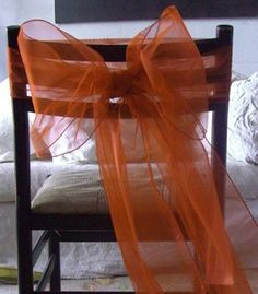 11.50 SALE PRICE! Orange organza chair sashes measure 9 inches wide x 3 yards long and come in a pack of 10. The chair sashes are constructed of fully seamed...