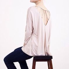 """CLEARANCE """"Caged Butterfly"""" Top Long sleeve top with a caged back. Subtle style! Brand new without tags. Bare Anthology Tops"""
