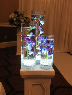 blue orchid wedding | MEWS Designs » Blog Archive » Blue Orchid Wedding » MEWS Designs  Instead of the thing they are sitting on being stone if rather it metal/silver