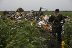 Malaysia Airlines Flight M17: 'Terrorist Death-Hunters' Loot Crash Site Stealing Jewellery and Cash from Dead......................WHY? NO RESPECT.