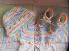 THIS RAINBOW SWEATER IS MADE TO ORDER for boy or girl. I will need up to 2 weeks to complete then shipping thereafter.  The set above is ready to ship size 0 or even preemie. Chest size 16 adjustable down to 12. Cap is 12 diameter, can be made adjustable with ribbon. I can take the shell border off if you wish for a boy. Booties are 3 and also adjustable with ribbon. The baby booties with the ruffled bottom is for girls (on the left). The baby booties plain is for boys (on the right).  Let…