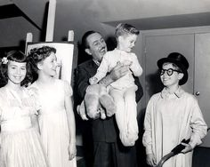 Walt Disney with the cast of child actors who voiced Peter Pan!