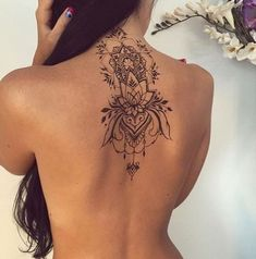 Lotus Flower Tattoo on Back of Neck.