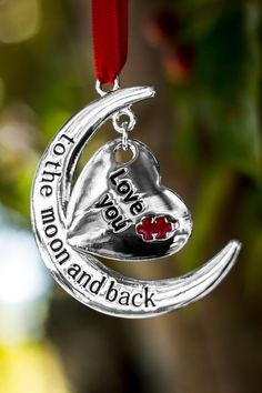 "Decorate your tree with encouragement for those on the autism spectrum. This heartwarming silver-tone ornament features a bold red puzzle piece and the words: ""Love you to the moon and back."" A true declaration of where your heart is!"