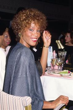 Smiling here, but we lost her too soon. (Whitney Houston)