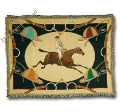 "Celebrated Century - Horse Racing Throw. Inspired by 19th century horse racing art, center of throw features a horse and jockey in full flight.  Detailed border of bridles, bits and colorful racing helmets. Neutral tan background, perfect fit for any decor. Specially designed and exclusive to Horse and Hound. Made of thick comfortable 100%  cotton. Curl up and dream of past turf triumphs!  Made in the USA.  50""x70""."