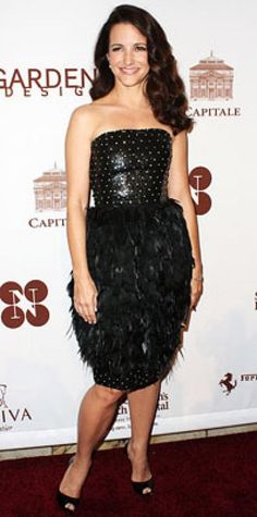 Look of the Day › May 29, 2009 WHAT SHE WORE A sequin strapless Oscar de la Renta cocktail dress with a feathered skirt WHERE The Chocolat au Vin benefit for St. Jude's Children's Research Hospital at Capitale in New York City