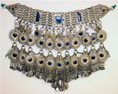 Antique Silver Lapis Afghan Coin Necklace One of a kind antique silver necklace with high quality, natural lapis-lazuli gems set on genuine, old afghan silver coins. The necklace was discovered by Gary W. Bowersox, The Gem Hunter in Afghanistan.