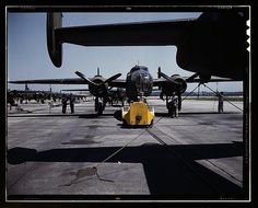 A fast, hard-hitting new A-20 [i.e., B-25] attack bomber is brought for a test hop to the flight line at the Long Beach, Calif., plant of Douglas Aircraft Company  (LOC)