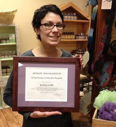 Jessica Grill of Pompeii Street Soap Company proudly displays her certificate.  YAY Jess!