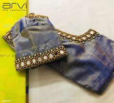 Beautiful blue shade designer blouse with hand embroidery mirror and bead work on sleeves and neckline. Blouse Back Neck Designs, Brocade Blouse Designs, Pattu Saree Blouse Designs, Simple Blouse Designs, Stylish Blouse Design, Designer Blouse Patterns, Bridal Blouse Designs, Simple Designs, Mirror Work Blouse Design