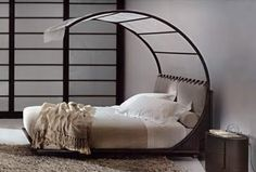 This bed would be cute for a little girls room... Add a little color.. LOVE IT