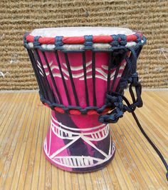 African hand made Djembe drum from Ghana Ghanaian djembe drum is a light wood drum with a small head but an impressive bass, tone, slap definition for its size. A great drum for children, travelers, or adults wanting an affordable first Djembe with an authentic African sound. Please note the Ghanaian Djembe Drum is hand made and therefore every drum is unique. The carvings, fabric, colour and rope may vary from those pictured, while the quality will remain at our high standard. Height…