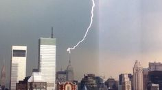 Spectacular Lightning Strikes Empire State Building... A lightning just struck the antenna spire of the 102-story, 1,454-feet (443.2 meter) tall Empire State Building during a storm in New York today 22 June 2012). As usual, the skyscraper didn't suffer any damage. The Empire State's Art Deco spire was designed to be a mooring mast for zeppelins. It never happened due to severe air drafts.