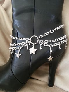 Three Strand Boot Anklet with drops of Stars with Rhinestones. It has an extender and a lobster claw clasp which fits any size of boot. The