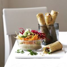 Spring rolls with crispy greens and sesame dip.