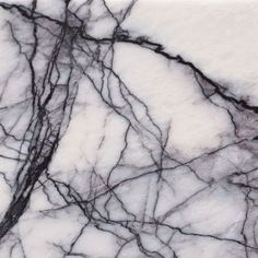 Honed Violeta marble by Agora Surfaces, White marble with strong, black-purple, hairline veining and light greyish purple shadow. Somewhat similar to New York marble.
