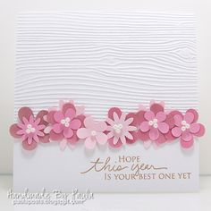 card ...Handmade By Paula: Moxie Fab Tuesday Trigger  ... row of punched and layered flowers with pearl centers ... wood grain embossing folder on top ... smooth card stock with the sentiment ... inspired by a photo of petit fours ... lovely!!