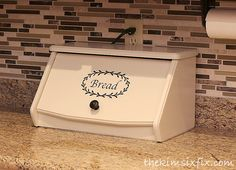 Hide a charging station in a vintage breadbox.
