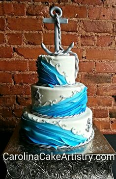 Awesome nautical wedding cake with edible anchor topper!
