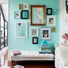 Really make your fashion illustrations pop by hanging them on a bright wall. It's even better when you match the shades of the wall and the illustrations. Hot pink and Tiffany blue are great choices.