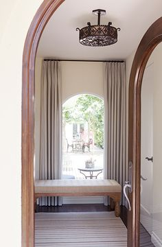 A Light, Bright, and California Cool Space// arched doorway, vintage lighting