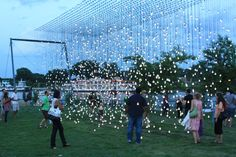 As it begins to get dark guests move to look at the Scattered Light exhibit