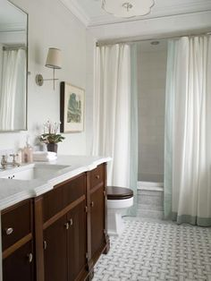 Double panels as shower curtains, marble vanity w/ pretty edge detail, basket-weave tile mosaic. square under-mount sink, full-mount light fixture. via: the HUNTED INTERIOR