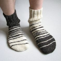 These Asymmetrical Hand-Knitted Men's Socks are from Miletta in Moldova. They are in 100% natural, undyed wool for $34.87 on Etsy. I want two pair and wear them mismatched. Then when people don't notice my socks match I'd laugh at how foolish they are.