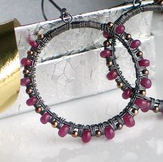 Deluxe handmade ruby earrings-perfect for July Birthstone, an original artisan design made with gemstones, oxidized silver and gold. Coiled