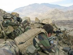 Somewhere in Afghanistan, a french sniper using a 12.7 PGM rifle, and his spotter