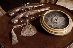 Dueling pistols, Garter Star and chain mail purse belonging to John, 1st Duke of Marlborough, part of the first-ever temporary exhibition at Chartwell, the former country home of Sir Winston Churchill in Kent
