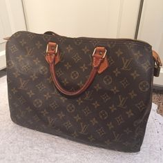 "Vintage Louis Vuitton Speedy 35 Vintage and in great condition AUTHENTIC Louis Vuitton Speedy 35 in monogram print. This is a beautiful bag. Includes lock and key. No dust bag. Serious buyers only. No trades please. Measurements are 14""x9""x7.5"" Louis Vuitton Bags Totes"