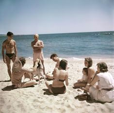 Pablo Picasso on the beach with friends and family, Vallauris, France (Robert Capa, 1948)