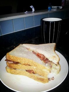 Triple bacon and egg sandwich and a large tea  fatty food