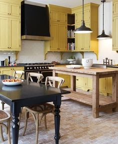 Yellow painted kitchen cabinets
