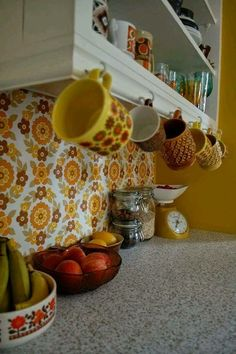 I'm almost certain my mom had wallpaper very similar to this in her kitchen at our old house in the late '70s.